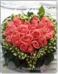 "Our Fresh Pink Rose Heart shape arrangment can say so much with an ""I Love You""."