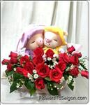 a pair of small PIG(20cm height) with 20 roses.Show her your true feelings with this elegant arrangement