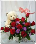 This lovely bouquet sends best wishes for any occasion with a dozen beautiful red roses and teddy bear with love.